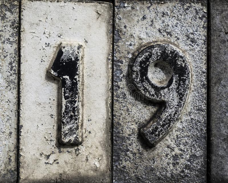 Written Wording in Distressed State Typography Found Number 19 nineteen. Written Wording in Distressed State Typography Found Number on a sign royalty free stock photo