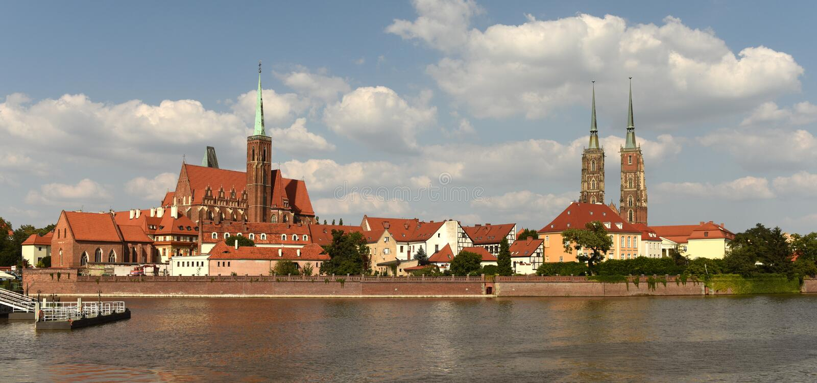 Wroclaw cityscape with Church of the Holy Cross and St. Bartholomew and Cathedral of St John the Baptist with river Odra in royalty free stock photos