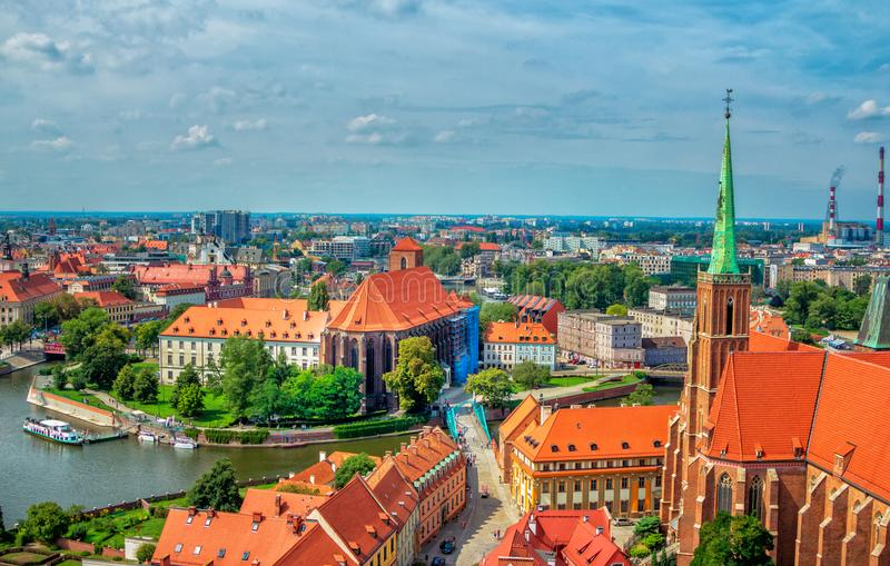 Aerial panoramic cityscape of Wroclaw. Wroclaw/Poland- August 18, 2017: aerial panoramic cityscape of Tumski Island and bridge, river Odra with touristic boat stock images