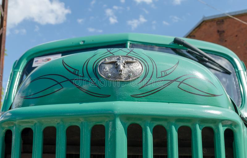 WROCLAW, POLAND - August 11, 2019: USA cars show: Old Dodge car. Green Vintage renovated hood with logo against blue sky. Close-up stock images