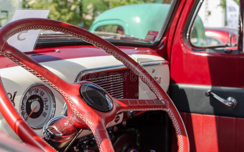 WROCLAW, POLAND - August 11, 2019:  USA cars show: 1951 Renovated Ford F-100 Pickup Truck of red and white colors. Close-up of stock image