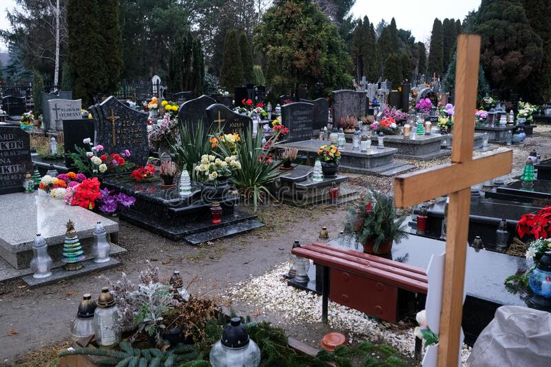 Graves in the cemetery of Holy Spirit, Wroclaw. Wroclaw, Poland - 19 January 2020: graves in the cemetery of Holy Spirit Swietego Ducha at  Bardzka street in royalty free stock images