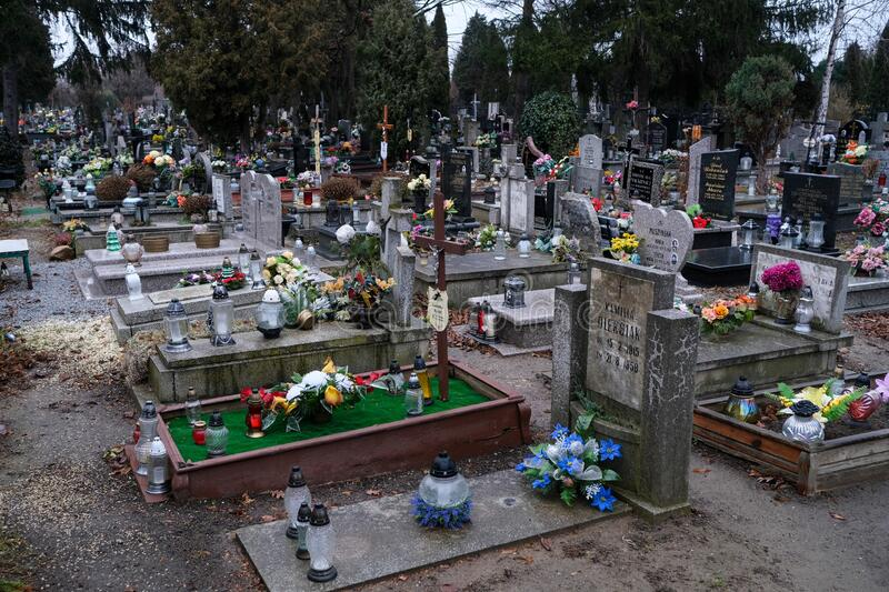 Graves in the cemetery of Holy Spirit, Wroclaw. Wroclaw, Poland - 19 January 2020: graves in the cemetery of Holy Spirit Swietego Ducha at  Bardzka street in stock photography