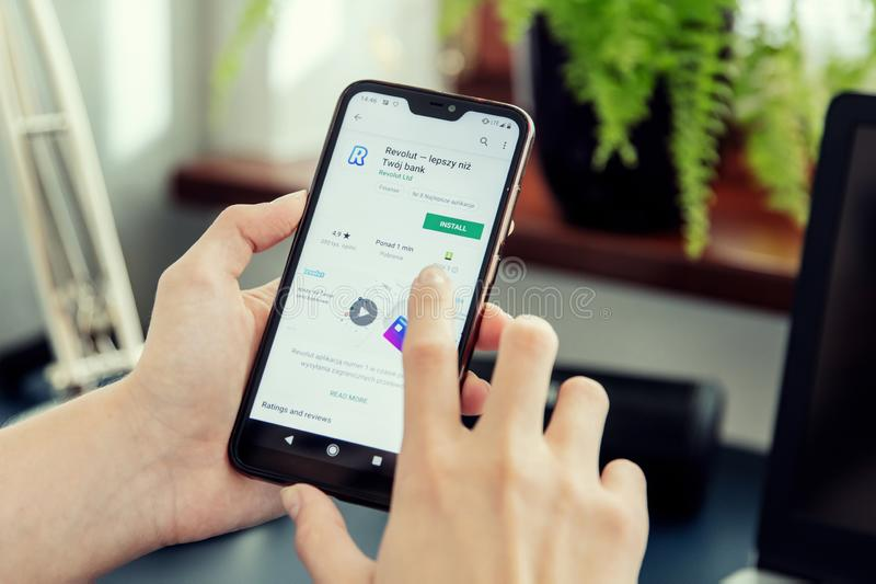 WROCLAW, POLAND - JULY 31th, 2019: Woman installs Netflix application on the Xiaomi A2 smartphone. royalty free stock photos