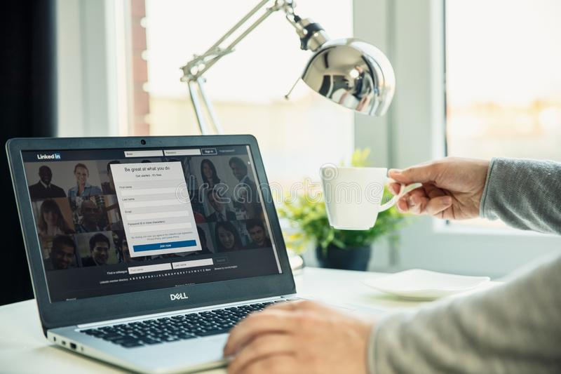 Modern laptop on the desk in office with Linkedin website on the screen. stock photography
