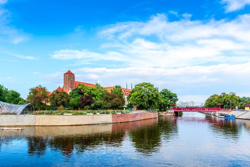 Wroclaw, Poland Ostrow Tumski island. Wroclaw, Poland panorama of Ostrow Tumski island, Odra or Oder river and red bridge stock photos