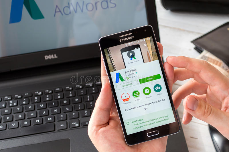 WROCLAW, POLAND- SEPTEMBER 09th, 2016: Businessman prepares to installs Google Adwords application on Samsung A5. stock photography
