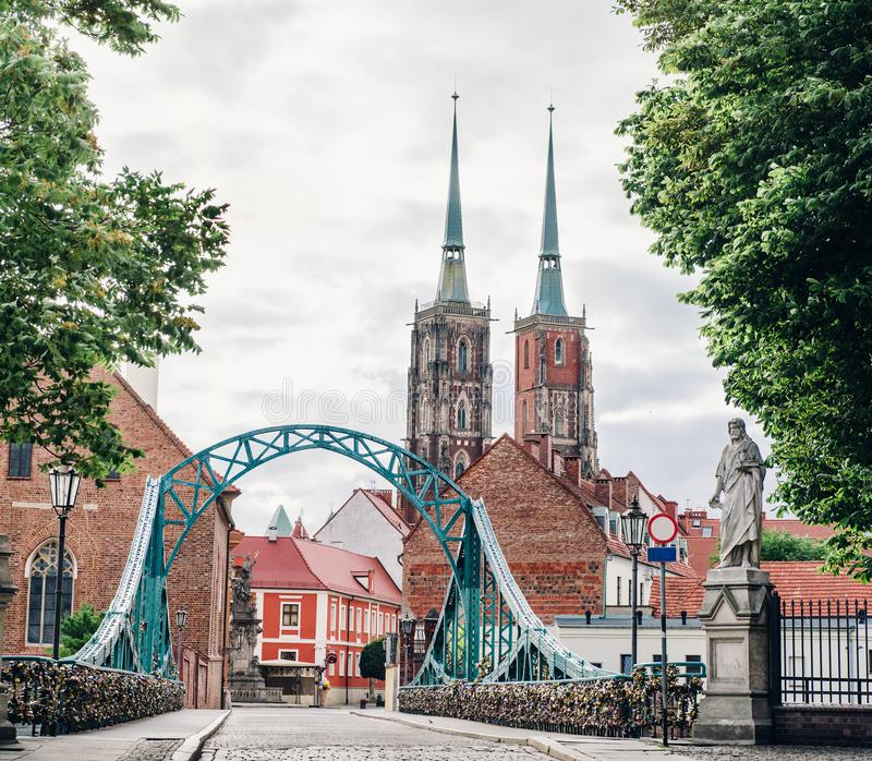Wroclaw. Poland. View at Tumski island and Cathedral of St John the Baptist with bridge through river Odra. Picturesque landscape of summer morning with blue royalty free stock photos