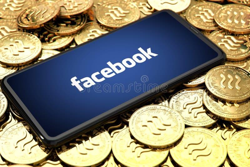 WROCLAW, POLONIA - 20 de junio de 2019: Facebook anuncia cryptocurrency del libra Smartphone con el logotipo del facebook en la p imagen de archivo libre de regalías