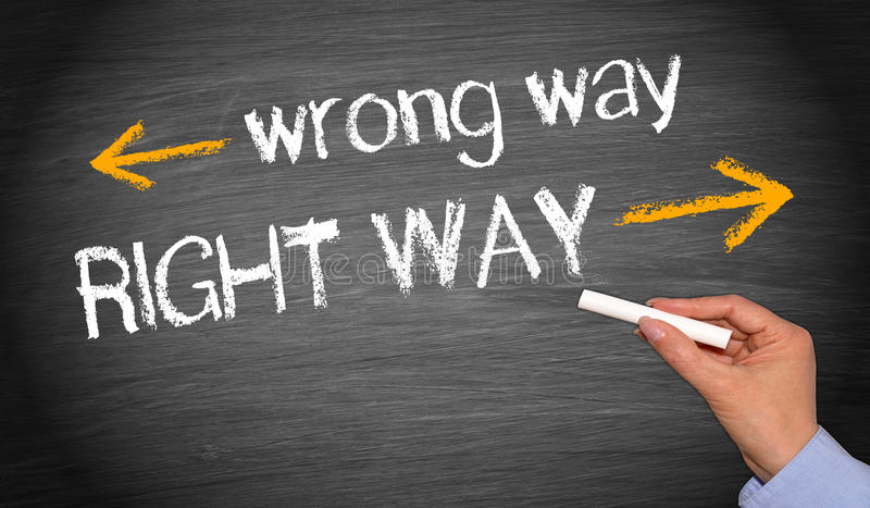 Wrong and right way. Right way and wrong way. Business, coaching, mentoring or goal setting or direction image with female hand, text and arrows stock photo
