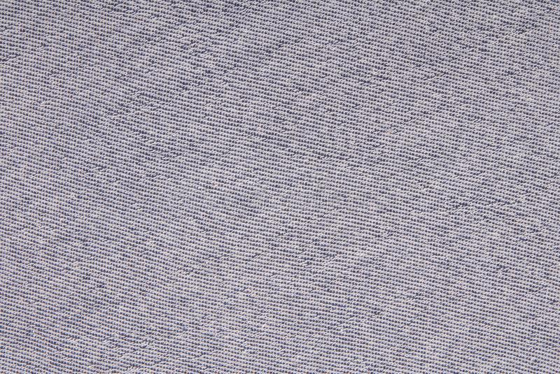 the wrong side of the light blue knitted fabric, material backgrounds, cloth texture, empty space, knitted textile royalty free stock image