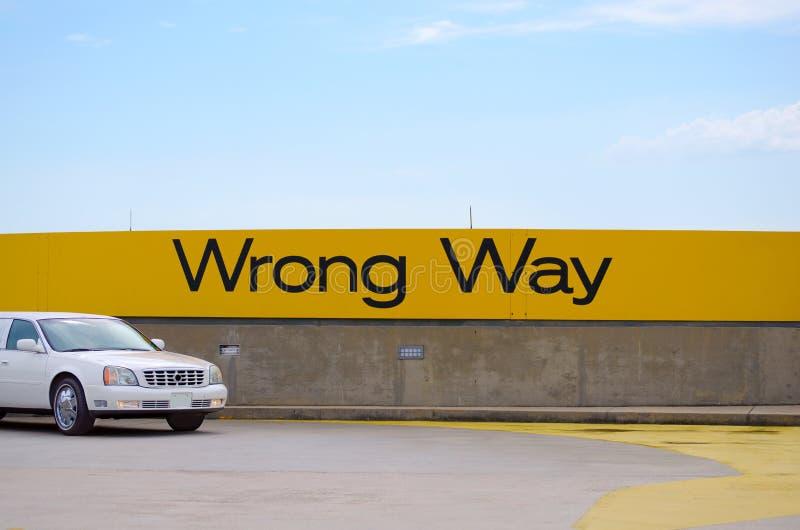 Wrong Way sign. Wrong Way wall signage on airport rooftop royalty free stock photos