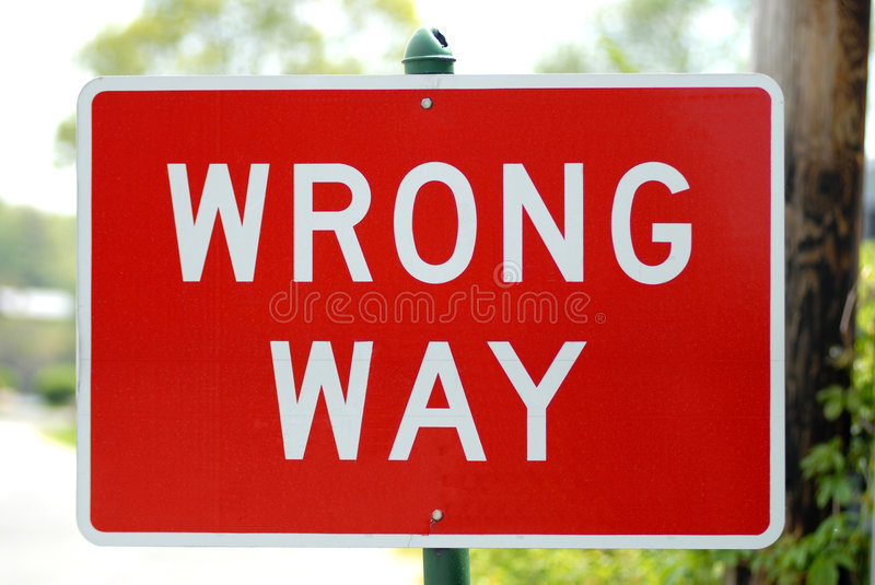 Wrong Way Sign. Red and white wrong way traffic sign stock photography
