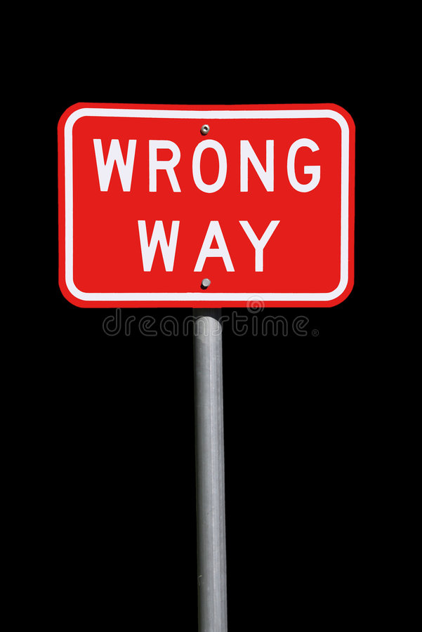 Wrong Way Traffic Sign - Isolated on Black stock photo
