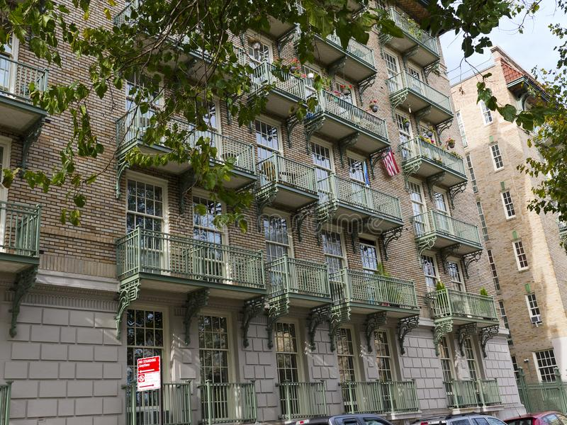 Wrought iron balconies on a. Large apartment brick building in Manhattan New York stock photography