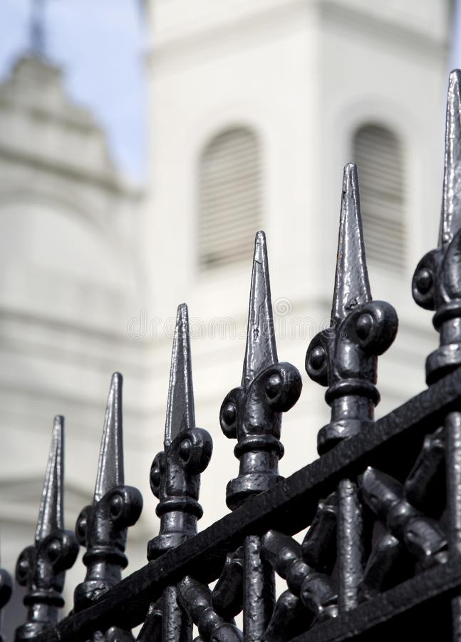 Wrought iron fence and Saint Louis Cathedral in New Orleans. Louisiana USA royalty free stock photo