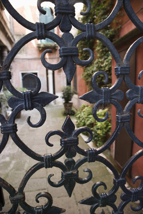 Wrought iron gate in Venice, Italy. stock photos