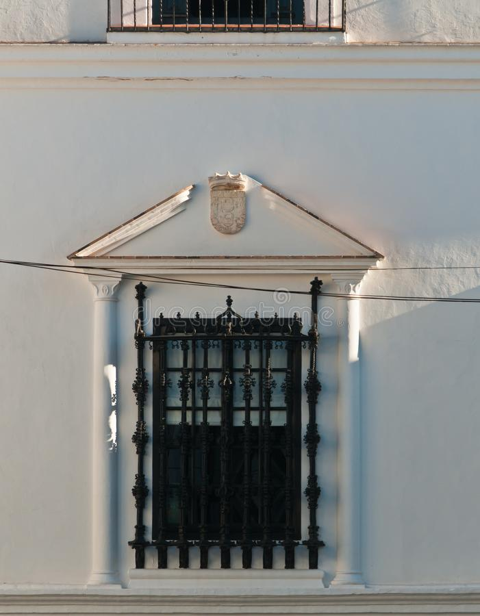 Wrought iron window protection on a spanish public building. Front view, medium distance of a window wrought iron gates for, protection on a spanish public royalty free stock photo