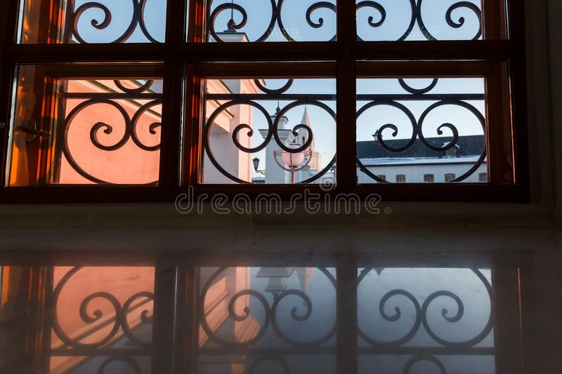 Wrought iron window. Grille on an old house stock photos