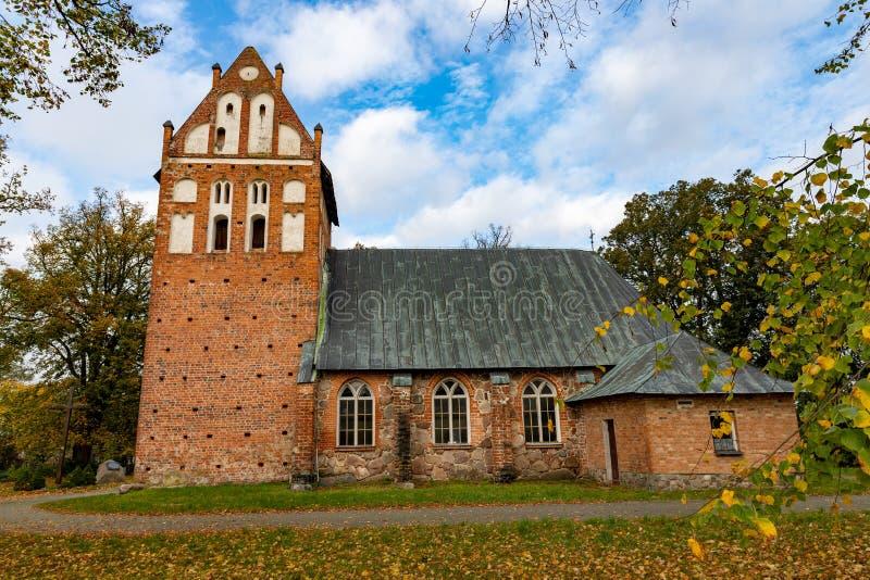 Wrzosowo, zachodniopomorskie / Poland - October, 22, 2019: Christian church in Central Europe. Old brick temple building. Autumn season, ancient, architecture stock image