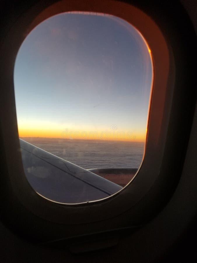 Wschód słońca dla płaskiego okno fotografia stock