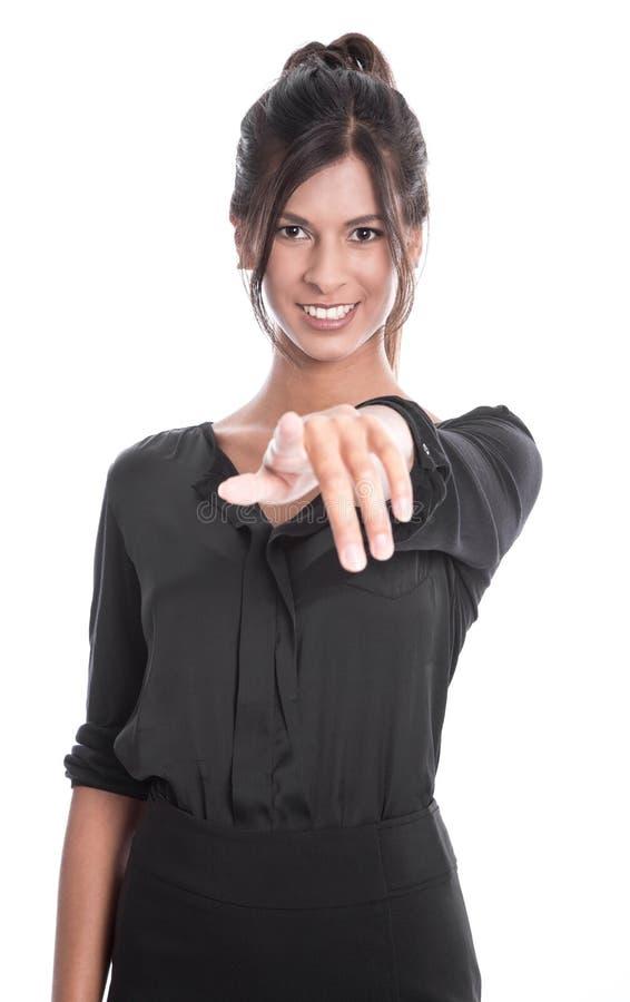 Wspaniała kobieta w czarny wskazywać przy kamerą odizolowywającą na białym bac obraz stock