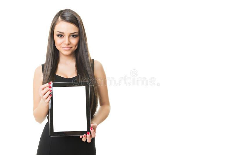 Wspaniały bizneswoman pokazuje pastylka komputer obraz royalty free