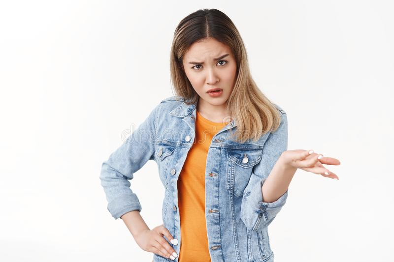Wtf that. Questioned intense clueless asian blond girlfriend complaining raise hand full dibelief stare camera puzzled royalty free stock photography