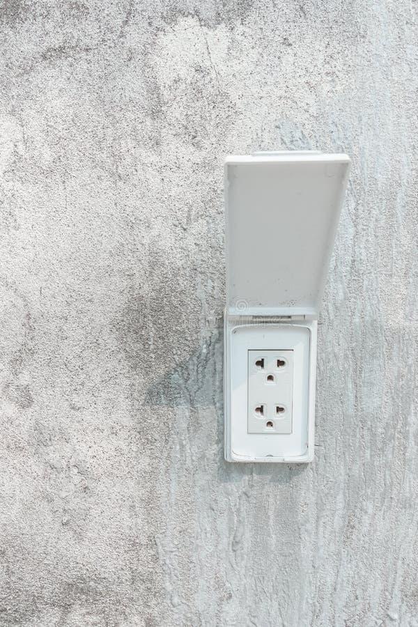 Wtyczkowa nasadka na cement ścianie obrazy royalty free