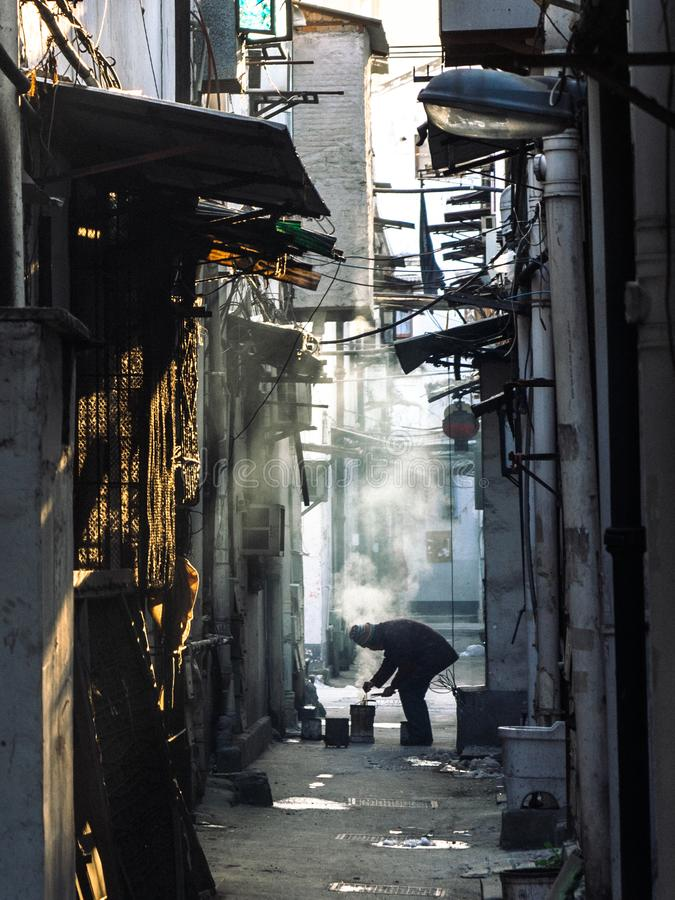 MAKING A FIRE IN A HUTONG royalty free stock images