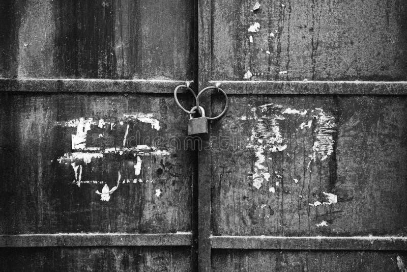 LOCKED OLD BLACK GATE royalty free stock photos