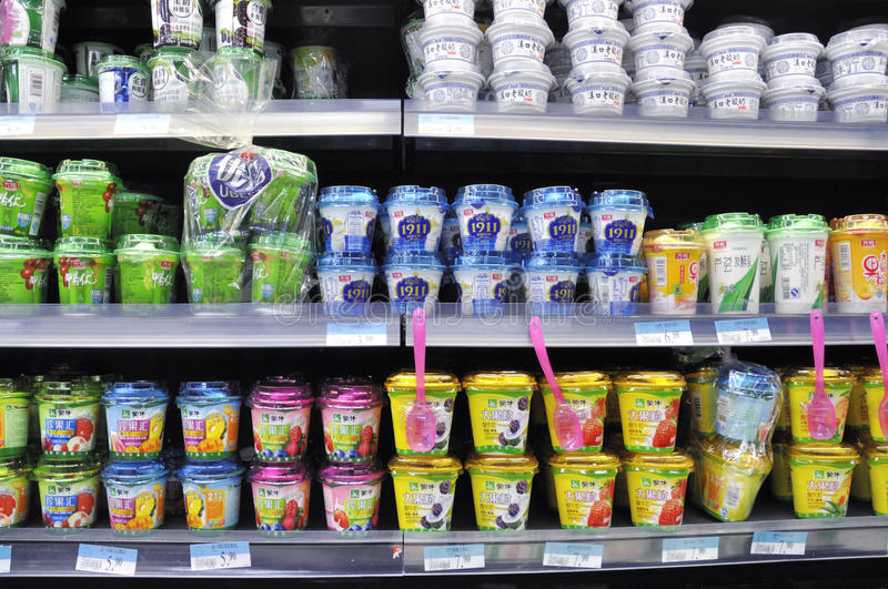 Wuhan, China. wal mart supercenter. Shopping for fresh milk, drink on sale at a modern wal mart supermarket in wuhan, China Photo taken during the spring festive stock photos