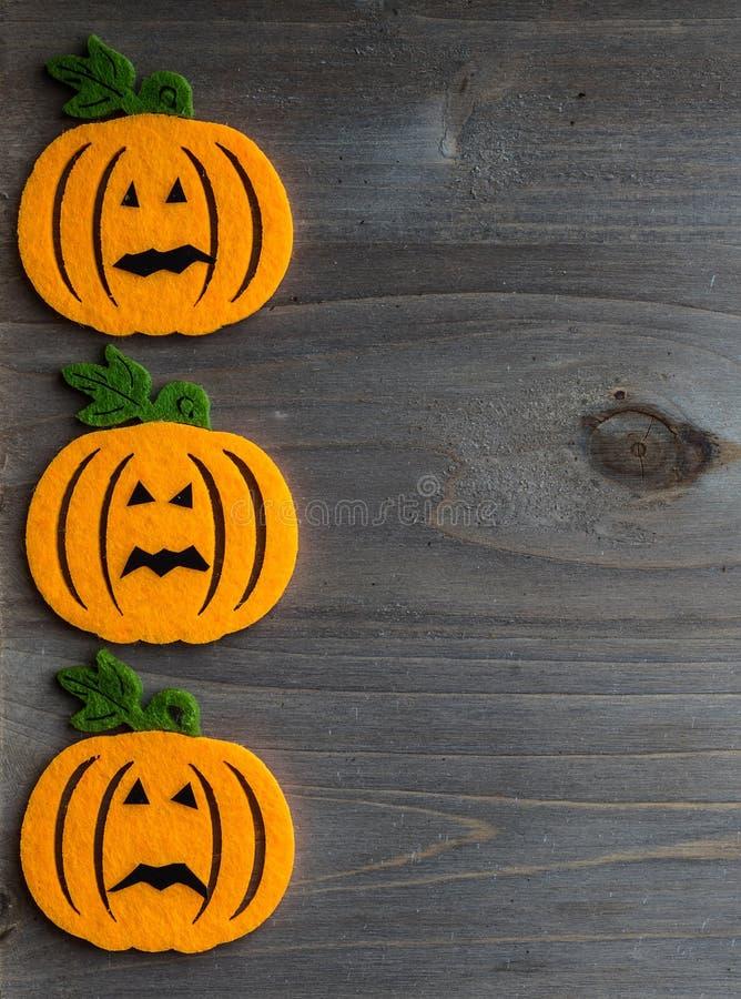 Wunderlicher Halloween-Hintergrund der handgemachten Filzsteckfassung-olaterne lizenzfreie stockfotografie