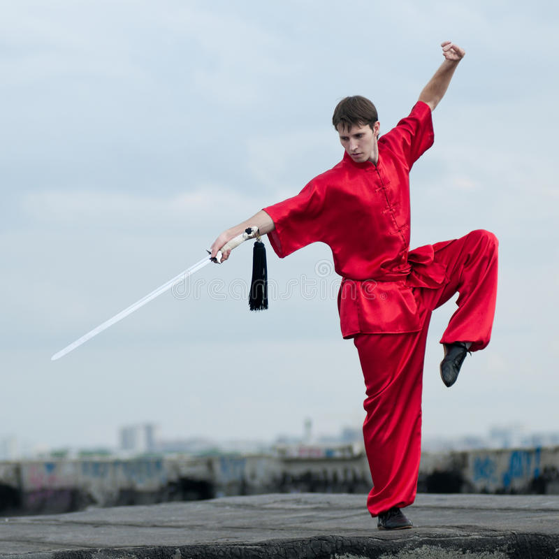 Wushoo man in red practice martial art stock images
