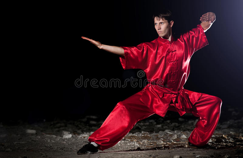 Wushoo man in red practice martial art. Shaolin warriors wushoo man in red practice martial art outdoor. Kung fu royalty free stock photos