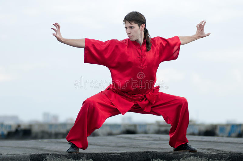 Wushoo man in red practice martial art. Shaolin warriors wushoo man in red practice martial art outdoor. Kung fu stock images