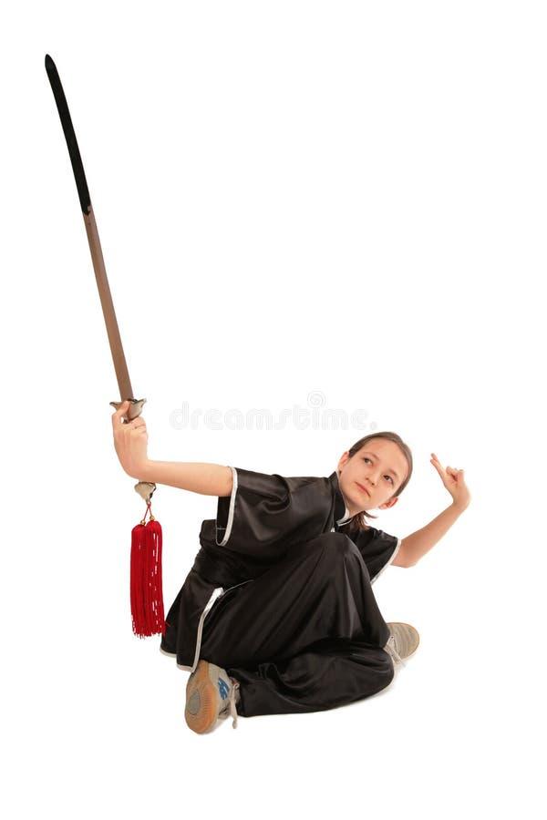 Wushu girl with sword stock photos