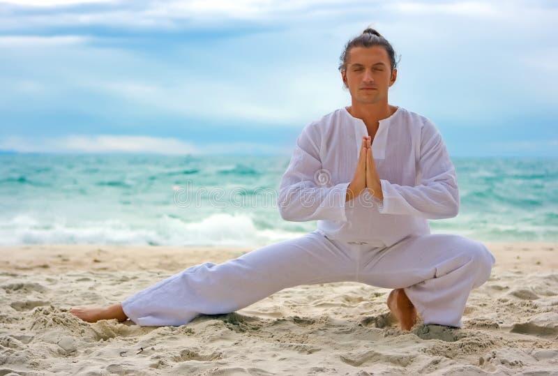 Wushu man on the beach stock photos