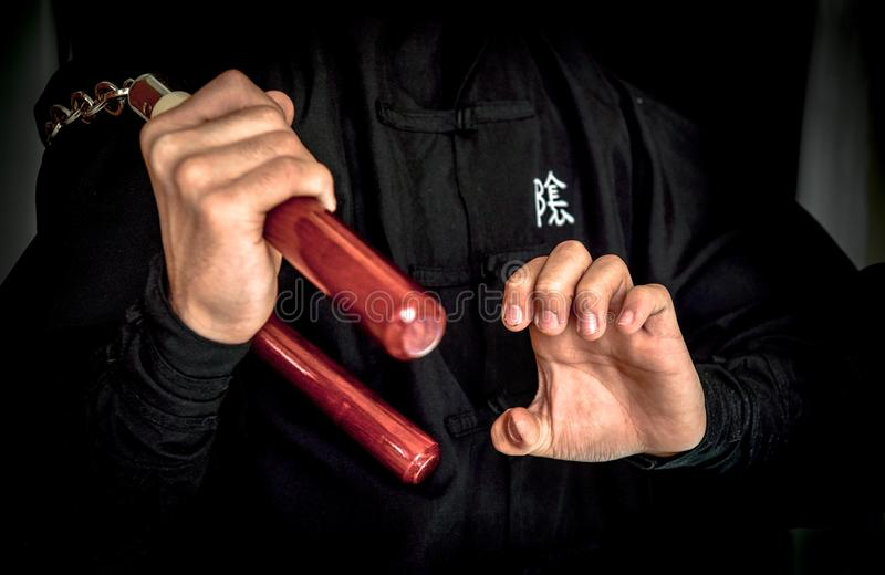 Wushu . skill with nunchuck. royalty free stock images