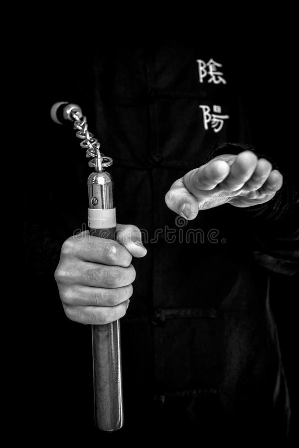 Wushu . skill with nunchuck. stock images