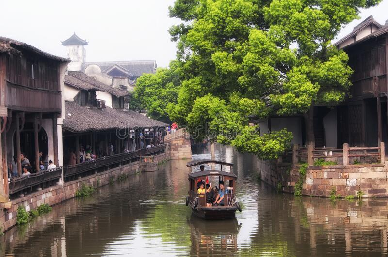 Wuzhen china water town tourist boats, bridge and buildings. The traditional chinese architecture lining the water canals in Tongxiang Wuzhen town east view stock images