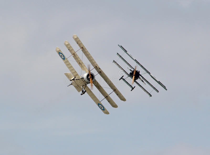Ww1 triplane dogfight. Photo of a WW1 aerial dogfight display between two vintage triplanes on display at herne bay air show on 15th august 2015 ideal for air stock image