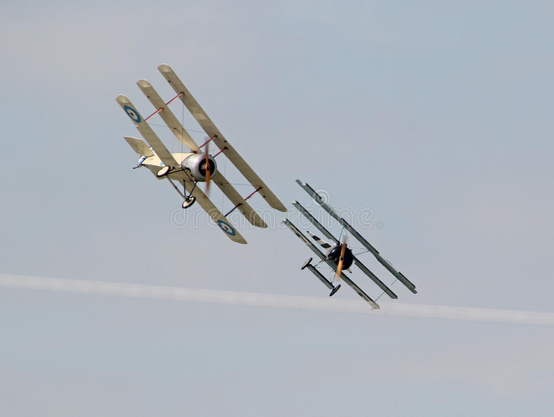 Ww1 triplane dogfight. Photo of a WW1 aerial dogfight display between two vintage triplanes on display at herne bay air show on 15th august 2015 ideal for air stock photography