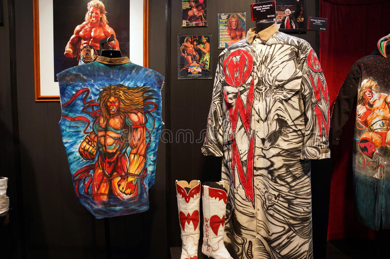 WWE Legend the Ultimate Warrior OWN outfit and photo display. SAN JOSE - MARCH 28: WWE Legend the Ultimate Warrior OWN outfit and photo display at WWE Axxess stock photo