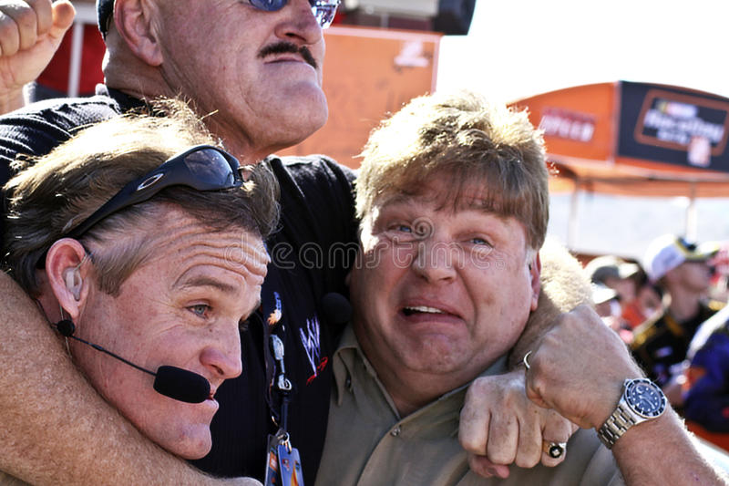 WWE's Sgt. Slaughter grabs Speed TV guys. Sgt. Slaughter puts Speed TV's NASCAR Sprint Cup show celebrities Kenny Wallace and Jimmy Spencer into a headlock at stock photos