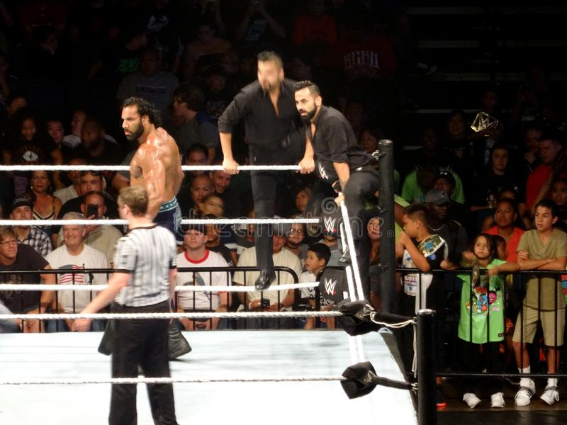 WWE Wrestler Jinder Mahal stands in ring with The Singh Brothers during pre-match ritual in WWE ring. Honolulu - September 13, 2017: WWE Wrestler Jinder Mahal stock photo