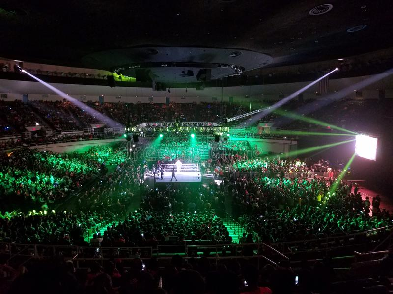 WWE Wrestler makes entrance in ring with crowd watching at WWE event. Honolulu - September 13, 2017: WWE Wrestler makes entrance in ring with crowd watching at stock image
