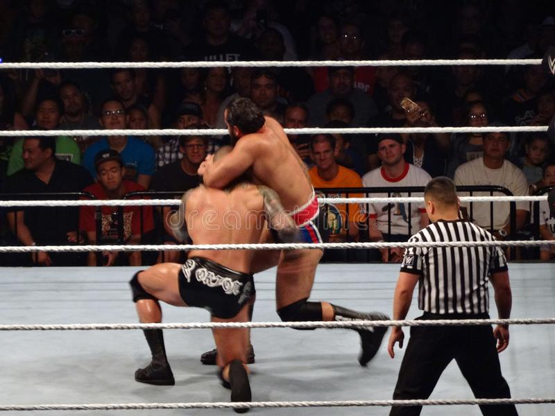 WWE Wrestler Rusev puts wrestler Randy Orton in finisher the Accolade submission in WWE ring. Honolulu - September 13, 2017: WWE Wrestler Rusev puts wrestler stock photography