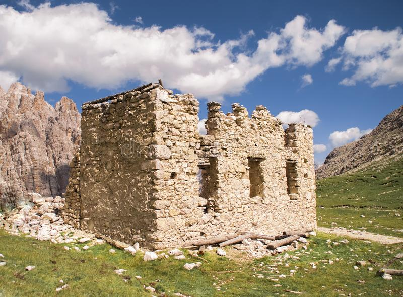 WWI ruins of shelter in the Italian Alps. WWI ruins of shelter near the village of Misurina, in the Dolomite UNESCO reserve in the Italian Alps stock image