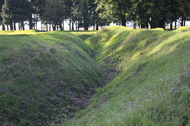 WWI trenches. All overgrown with grass are a memorial to those who fought and died in Belgium and France Europe during the Great War of 1914-18 royalty free stock photos